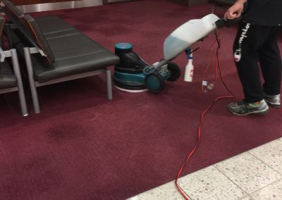 One of our skilled cleaners doing low pressure cleaning in Watpac's Adelaide office