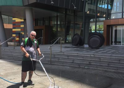 Cleaning the external tiled floor in an Adelaide commercial office building